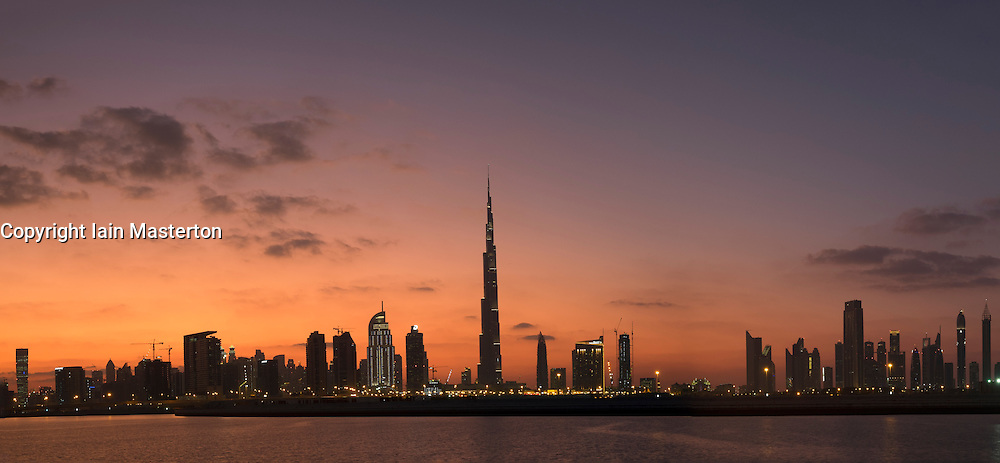 Evening skyline panorama of modern buildings and Burj Khalifa in United Arab Emirates
