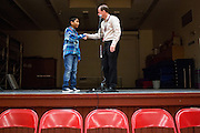 Casey McMurray congratulates seventh grader Jaz Reyes for winning the 1st Annual Spelling Bee at Rancho Middle School in Milpitas, California, on December 9, 2015. (Stan Olszewski/SOSKIphoto)