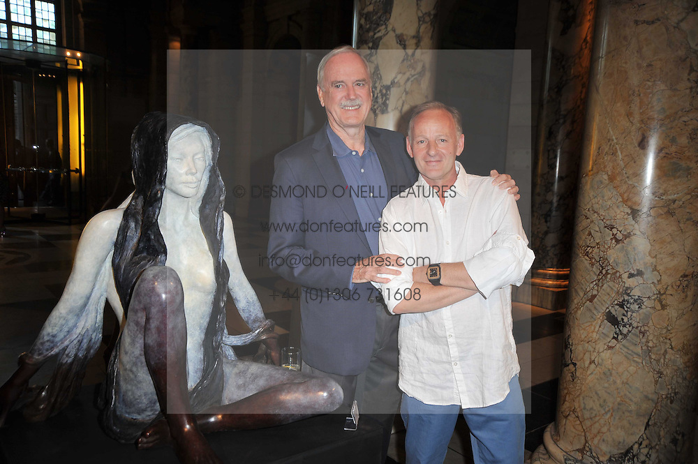 Left to right, JOHN CLEESE and artist JONATHAN WYLDER at a private view of a new collection of bronzes and original paintings by artist Jonathan Wylder and his muse Jennifer Wade held at the V&A Museum, London on 27th April 2011.