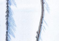 THEMENBILD - Bäume werfen schatten auf die schneebedeckte Landschaft mit einem Weg, aufgenommen am 5. Feber 2018 in Zell am See - Kaprun, Österreich // Trees cast shadows on the snow-covered landscape with a path, Zell am See Kaprun, Austria on 2018/02/05. EXPA Pictures © 2018, PhotoCredit: EXPA/ JFK