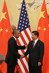 epa04486015 US President Barack Obama (L) and Chinese President Xi Jinping shake hands during a press conference at the Great Hall of the People (GHOP) in Beijing, China, 12 November 2014. Obama is in China to attend the Asia-Pacific Economic Cooperation (APEC) 2014 Summit and related meetings.  EPA/HOW HWEE YOUNG