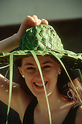 CUBA, GUARDALAVACA..Tourist with hat made from palm leaves..(Photo by Heimo Aga)