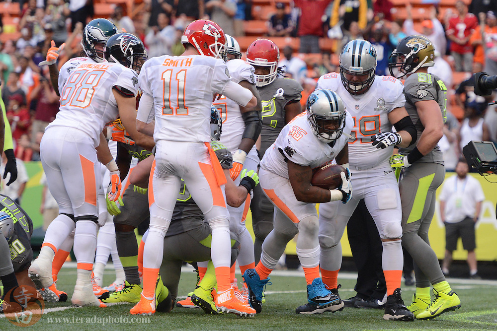 January 26, 2014; Honolulu, HI, USA; Team Rice fullback Mike Tolbert of the Carolina Panthers (35) scores the game-winning two-point conversion during the fourth quarter of the 2014 Pro Bowl against Team Sanders at Aloha Stadium. Team Rice defeated Team Sanders 22-21.