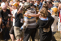 In August the annual cheese rolling contest brings athletic contestants to Whistler, BC, Canada. The first to catch the rolling cheese as it heads down Blackcomb Mountain wins a seasons' ski pass. The winner of the Men's Race celebrates his win.