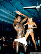 Two strippers dancing on stage in a club, Ibiza, 1998