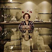 PORTRAITS OF SURVIVORS AND IMMIGRANTS <br /> Sobreviviente del Holocausto / Holocaust Survivor<br /> <br /> Sra. Magda Weisz de Hartman.<br /> <br /> Nació en Olaszliska, Hungría, el 12 de diciembre de 1922. Su madre falleció antes de la guerra siendo ella muy pequeña. En 1944, su padre, los hermanos y otros familiares fueron llevados a un gueto, y de ahí, casi entre los últimos deportados, a Auschwitz. Estuvo tambien en otros campos: Plaszow, Breslow y finalmente Bergen-Belsen, donde murieron dos hermanas y una prima. Al finalizar la guerra pudo emigrar a Estados Unidos, donde conoció a su esposo; tras la boda se instalaron en Venezuela<br /> <br /> Photography by Aaron Sosa<br /> Caracas - Venezuela 2009<br /> (Copyright © Aaron Sosa)