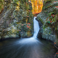 New England fall foliage framing Indian Well Falls in Shelton, Connecticut. Indian Well State Park is only a 25 minute drive from New Haven and rewards with this spectacular New England waterfall. <br /> <br /> Connecticut waterfall of Indian Well Falls photography images are available as museum quality photography prints, canvas prints, acrylic prints or metal prints. Prints may be framed and matted to the individual liking and decorating needs at:<br /> <br /> https://juergen-roth.pixels.com/featured/indian-well-falls-juergen-roth.html<br /> <br /> All high resolution Connecticut photography images are available for photo image licensing at www.RothGalleries.com. Please contact me direct with any questions or request. <br /> <br /> Good light and happy photo making!<br /> <br /> My best,<br /> <br /> Juergen<br /> Prints: http://www.rothgalleries.com<br /> Photo Blog: http://whereintheworldisjuergen.blogspot.com<br /> Instagram: https://www.instagram.com/rothgalleries<br /> Twitter: https://twitter.com/naturefineart<br /> Facebook: https://www.facebook.com/naturefineart