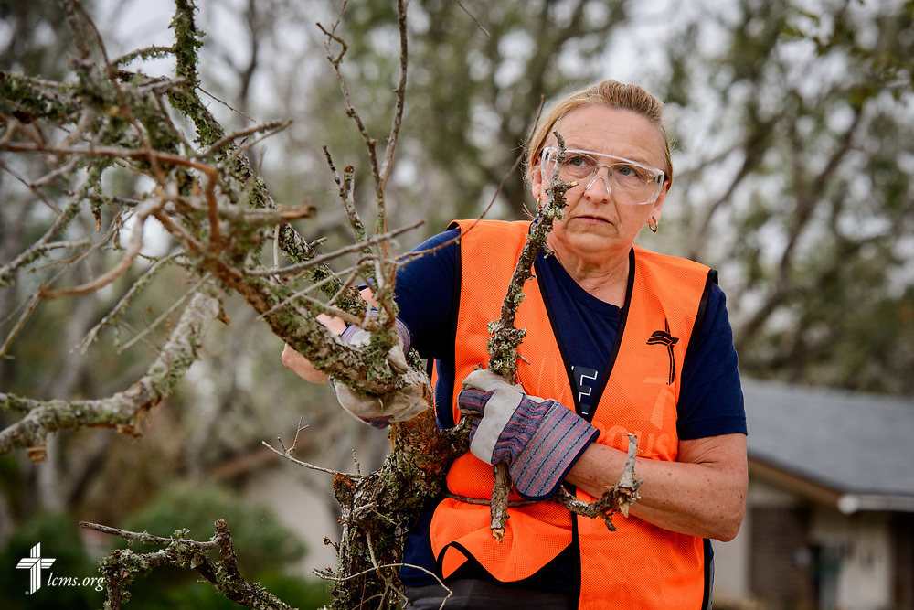 Peggy Winters, a volunteer from Parkers Prairie, Minn., removes fallen tree branches from a felled tree leftover from Hurricane Harvey at a home on Tuesday, Feb. 6, 2018, in Rockport, Texas. LCMS Communications/Erik M. Lunsford