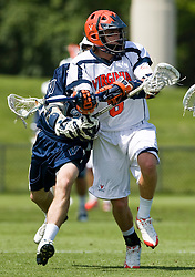 Virginia Cavaliers A Steele Stanwick (6) is tied up by Villanova Wildcats Attack Mike Brennan (13).  The #5 ranked Virginia Cavaliers defeated the #19 ranked Villanova Wildcats 18-6 in the first round of the 2008 NCAA Men's Lacrosse Tournament the University of Virginia's Klockner Stadium in Charlottesville, VA on May 10, 2009.