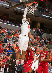 Virginia forward Mike Scott (32) dunks against UMD.  The Virginia Cavaliers defeated the Maryland Terrapins 68-63 at the John Paul Jones Arena on the Grounds of the University of Virginia in Charlottesville, VA on March 7, 2009.
