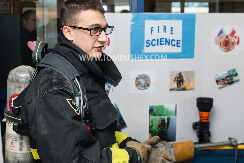 Goshen, New York - Fire science student Antonio Esposito of Goshen High School speaks to a visitor during the Orange-Ulster BOCES CTE (Career and Technical Education) media day on Feb.  18. 2016.
