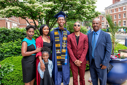 A graduating Howard student with his family.