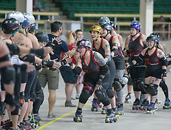 July 22, 2017 - Denver, Colorado, U.S - The Rocky Mountain Roller Girls high five the Denver Roller Girls before their match during the 7th. Annual Denver County Fair at the National Western Complex Saturday afternoon. (Credit Image: © Hector Acevedo via ZUMA Wire)