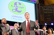 Nigel Farage MEP<br /> Leader of the UKIP Party <br /> addresses party members at a rally to talk about the diversity of the party prior to the European and local council elections. 7th May 2014. Winston McKenzie, Paula McQueen, Nicholas McQueen, Amjud Bashir, Suzanne Evans, Steven Woolfe, Rathy Alagaratnam. Emmanuel Centre, Westminster, London, Great Britain .