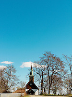 Rural church surrounded by bare trees