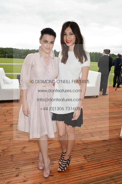 Left to right, KATIE McGRATH and GEMMA CHAN at the Audi Polo Challenge at Coworth Park, Blacknest Road, Ascot, Berkshire on 31st May 2015.