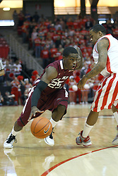 02 February 2013:  Anthony Beane Jr. drives inward challenging the defense of Tyler Brown during an NCAA Missouri Valley Conference mens basketball game where the Salukis of Southern Illinois lost to the Illinois State Redbirds for Retro-Night 83-47 in Redbird Arena, Normal IL