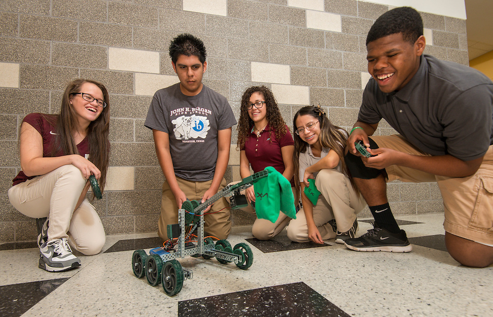 Robotics students work on a project at Reagan High School, September 16, 2014.