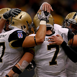 October 9, 2010; New Orleans, LA, USA;  Army Black Knights fullback Jared Hassin (7) is congratulated by teammates after a touchdown run against the Tulane Green Wave during the third quarter at the Louisiana Superdome. Army defeated Tulane 41-23.  Mandatory Credit: Derick E. Hingle
