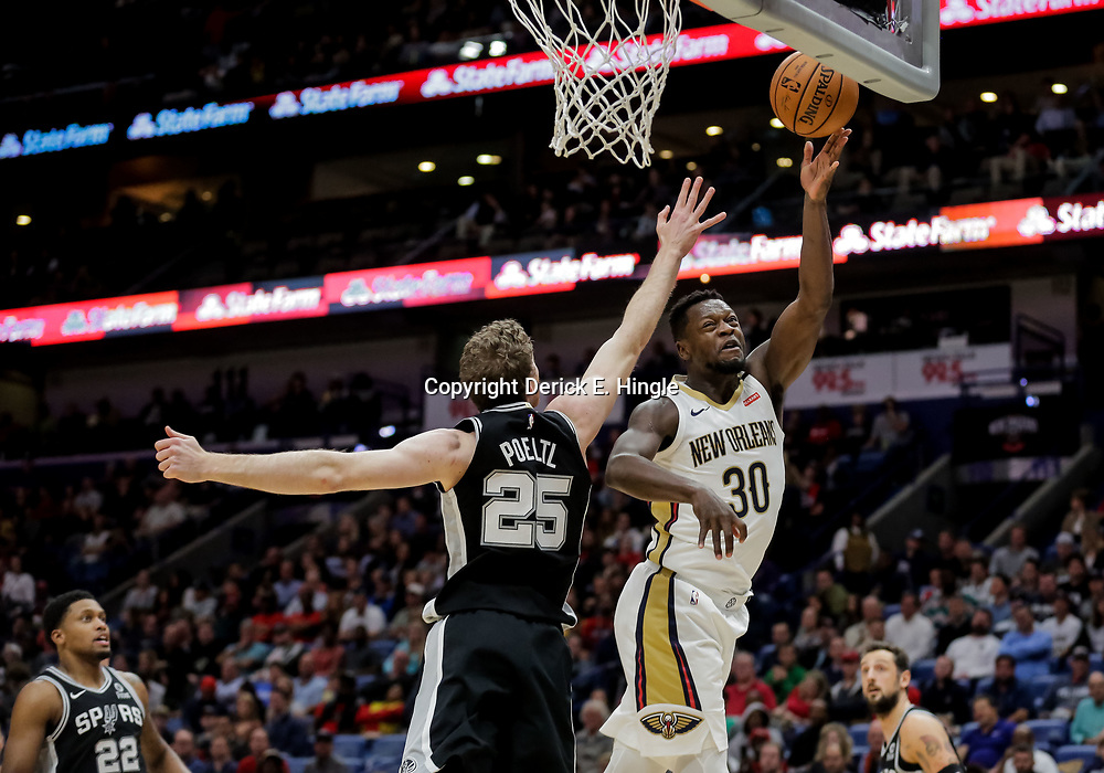 Nov 19, 2018; New Orleans, LA, USA; New Orleans Pelicans forward Julius Randle (30) shoots over San Antonio Spurs center Jakob Poeltl (25) during the first quarter at the Smoothie King Center. Mandatory Credit: Derick E. Hingle-USA TODAY Sports