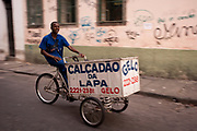 MAN DELIVERING ICE CREAM ON A BIKE SMILING AT CAMERA RIO