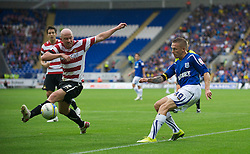 CARDIFF, ENGLAND - Saturday, August 21, 2010: Cardiff City's Craig Bellamy in action against Doncaster Rovers on his debut during the Football League Championship match at the Cardiff City Stadium. (Pic by: David Rawcliffe/Propaganda)