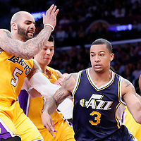 19 March 2015: Utah Jazz guard Trey Burke (3) drives past Los Angeles Lakers forward Carlos Boozer (5) and Los Angeles Lakers guard Jeremy Lin (17) during the Utah Jazz 80-73 victory over the Los Angeles Lakers, at the Staples Center, Los Angeles, California, USA.