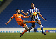Cole Skuse and Chris O'Grady, Brighton striker during the Sky Bet Championship match between Brighton and Hove Albion and Ipswich Town at the American Express Community Stadium, Brighton and Hove, England on 21 January 2015.