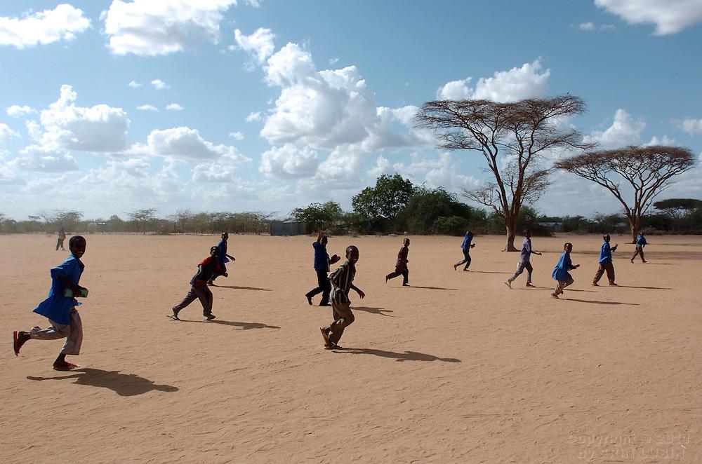 Children run through Dagahaley Refugee Camp in Dadaab, Kenya September 14, 2006. ..Photograph by Erin Lubin