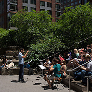 June 21, 2014 - New York, NY : <br /> The city was flooded with music on Saturday as Make Music New York brought more than 1,300 free concerts to the city's streets and parks. The annual festival's program included a performance by the Mass Appeal Chorus -- and guest musicians -- in Teardrop Park in lower Manhattan on Saturday afternoon. Fahad Siadat, foreground left, leads the group of assembled musicians. CREDIT: Karsten Moran for The New York Times