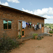 Irene Nakayima and Joseph Gabula's home in the village of Kitengeesa in the Central Region of Uganda on 30 July 2014. The couple work at Afripads, a social enterprise that manufactures reusable sanitary pads, where Irene is the Production Manager and Joseph is a driver. Through their income from the comapany they were able to acquire a piece of land and build their own home, and Irene was also able to complete a diploma in Social Administration.
