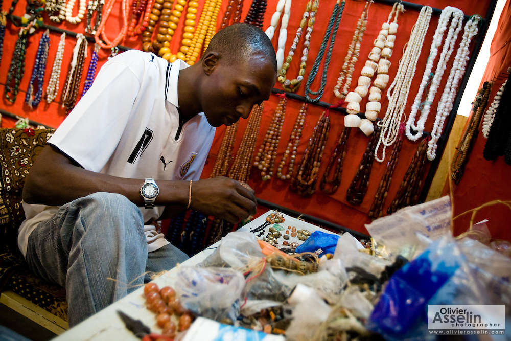 Men make jewelry at the Village Artisanal de Ouagadougou, a cooperative that employs dozens of artisans who work in different mediums, in Ouagadougou, Burkina Faso, on Monday November 3, 2008.