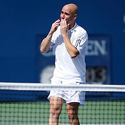 A visibly shaken Andre Agassi bids farewell to his beloved fans after his third round match against Benjamin Becker of Germany during the 2006 US Open Championship on September 3, 2006 in New York City.
