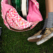 June 4, 2014 - New York, NY : A concertgoer lays down in the grass -- only her bag and shoes are visible --  as she waits for Janelle Monáe to take the stage and kick off the 2014 Celebrate Brooklyn! concert series in Prospect Park on Wednesday night.<br /> CREDIT: Karsten Moran for The New York Times