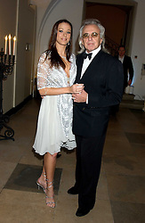 PETER STRINGFELLOW and BELLA WRIGHT at a dinner attended by the Conservative leader Michael Howard and David Davis and David Cameron held at the Banqueting Hall, Whitehall, London on 29th November 2005.<br />