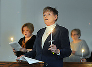 HILLTOWN, PA - APRIL 19:  Congregation members hold candles as they participate in the Holy Saturday Easter Vigil and Holy Eucharist at Good Shepherd Episcopal Church April 19, 2014 in Hilltown, Pennsylvania.  (Photo by William Thomas Cain/Cain Images)