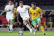 Milton Keynes - Tuesday, August 12th, 2008: Peter Leven (L) of MK Dons and Darel Russell (R) of Norwich City during the Carling League Cup First Round match at Stadium MK, Milton keynes. (Pic by Mark Chapman/Focus Images)
