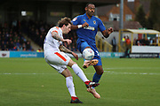 AFC Wimbledon midfielder Liam Trotter (14) battles for possession with Luton Town defender Glen Rea (16)  during the EFL Sky Bet League 1 match between AFC Wimbledon and Luton Town at the Cherry Red Records Stadium, Kingston, England on 27 October 2018.