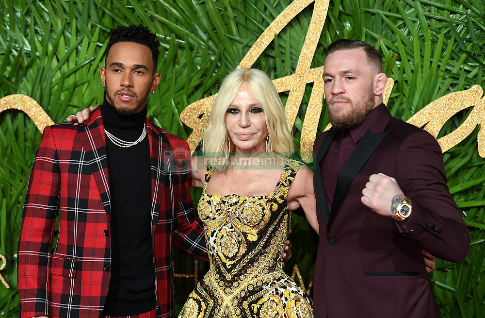 Lewis Hamilton, Donatella Versace and Conor McGregor attending the Fashion Awards 2017, in partnership with Swarovski, held at the Royal Albert Hall, London. Picture Credit Should Read: Doug Peters/ EMPICS Entertainment