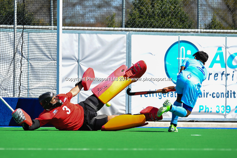 Kyle PONTIFEX of the Black Sticks defends a shot from Manpreet Singh of India during the Mens Hockey International, 2015 South Island Tour game between the New Zealand Black Sticks V India, at Marist Park, Christchurch, on the 11th October 2015. Copyright Photo: John Davidson / www.photosport.nz