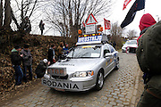 Belgium, March 31 2013: The course vehicle signals that the race is coming up the Oude-Kwaremont for the final time in the Ronde van Vlaandaren 2013 cycle race. Copyright 2013 Peter Horrell.