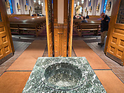 """15 MARCH 2020 - DES MOINES, IOWA: An empty holy water font in the vestibule of a Catholic church in Des Moines. The diocese of Des Moines announced that holy water fonts would be empty to prevent the spread of the Coronavirus. Most churches in the Des Moines area canceled their Sunday services or switched to an online service this week. Those churches that conducted Sunday services imposed """"social distancing"""" guidelines, including no physical contact, and had significantly lower attendance. The Governor of Iowa announced Saturday night that the Coronavirus in Iowa had entered the """"community spread"""" phase when a person in Dallas County, in the Des Moines metropolitan area, tested positive for Coronavirus. This is the first reported case in the Des Moines area. As of Sunday morning, Iowa was reporting 18 people tested positive for Coronavirus.          PHOTO BY JACK KURTZ"""