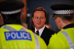 Leader of the Conservative Party David Cameron talks to Police officers at the  Manchester Central on the first day  of the Conservative Party Conference , Monday October 5, 2009. Photo By Andrew Parsons / i-Images.