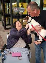 Natasha's beloved terrier Bailey visits her at the Royal Free hospital in Hampstead, where she had to stay for two weeks and undergo three operations to save her life. Natasha Bambrough, 48, from Ruislip in west London went to Turkey to have a tummy-tuck operation and subsequently gained an infection leading to necrosis that required three operations over a two week period, including a skin graft. London, May 14 2019.