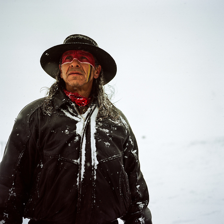 OCETI SAKOWIN CAMP, CANNON BALL, NORTH DAKOTA - DECEMBER 5, 2016: Walter of South Dakota helping to hold the front line of proseters on December 5th, 2016. Native Americans and up tp 700 veterans marched on December 5th in protest of the Dakota Access Pipeline at Standing Rock Indian Reservation.