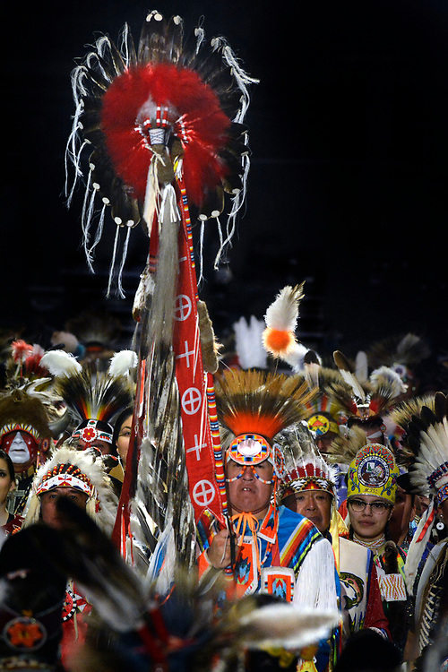jt042817c/a sec/jim thompson/ Terrance Goodwill of Saskatchewan, Canada carries the Eagle Staff for the Grand Entrance of the 2017 Gathering of Nations Pow-Pow held at Tingley Coliseum.   Friday April 28, 2017. (Jim Thompson/Albuquerque Journal)