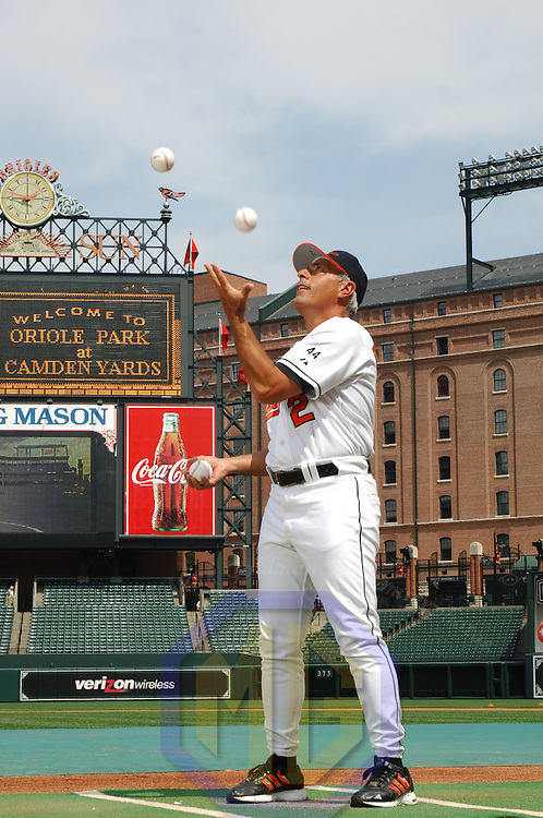 15 April 2006: Manager Sam Perlozzo of the Baltimore Orioles poses for a portrait as he juggles at Orioles Park at Camden Yards in Baltimore, MD.