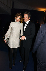 JEMIMA KHAN and HUGH GRANT at the British Red Cross London Ball held at The Room by The River, 99 Upper Ground, London SE1 on 16th November 2006.<br />