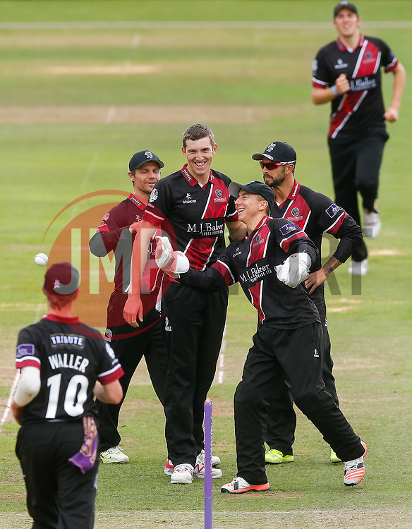 Michael Bates of Somerset celebrates with bowler Craig Overton after catching out Wes Durston of Derbyshire for 29 - Mandatory byline: Rogan Thomson/JMP - 07966 386802 - 26/07/2015 - SPORT - CRICKET - Taunton, England - County Ground - Somerset v Derbyshire Falcons -Royal London One-Day Cup.