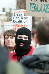 Masked demonstrator chants anti government slogans  in  Barkers Pool, outside Sheffield city Hall where the Liberal Democrats are holding their Party conference Conference Sheffield Saturday.12 March 2011.Images © Paul David Drabble